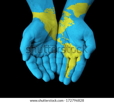 World map painted on hands.  - stock photo
