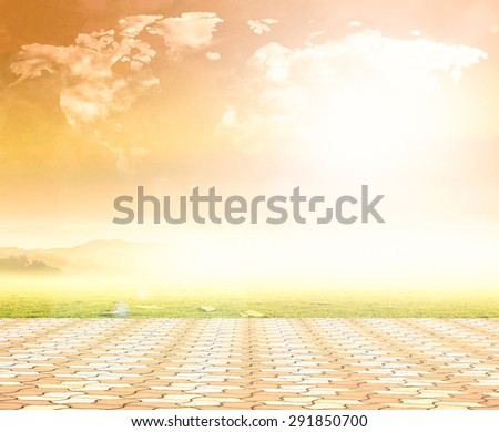 World map shaped clouds in beautiful sunset and stone paving. World Environment Day concept. Ecology concept. - stock photo