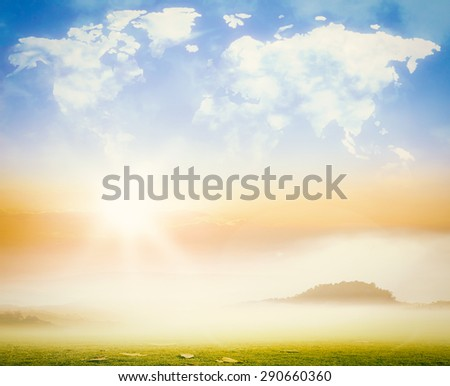 World map shaped clouds in beautiful sunset background. Ecology, International Mountain Day, World Environment concept. - stock photo