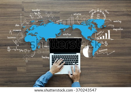 World map with creative thinking drawing charts and graphs business success strategy plan ideas,  With Man hand working on laptop computer keyboard with blank screen monitor, Top View
