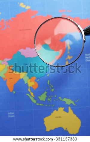 World map with magnifying glass. Worldly cuisine concept