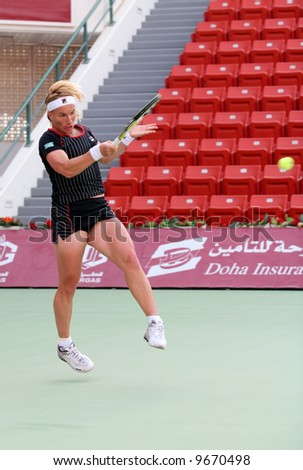 World No 2 Svetlana Kuznetsova in action at the Qatar Total Open, Doha, during her Feb 20, 2008, match against Frenchwoman Nathalie Dechy. - stock photo
