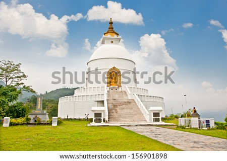 World peace pagoda in Pokhara Nepal.Designed to help unite people their search for world peace. Most pagodas built since World War II under the guidance of Nichidatsu Fuji, a Buddhist monk from Japan. - stock photo