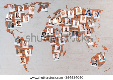 World population. Close-up image of brick world map with photographs of different people - stock photo