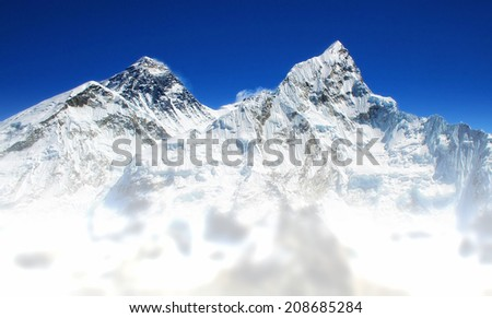 World's highest mountain, Mt Everest (left, 8850m) and Mt. Nuptse (right) in the Himalayas, Nepal - stock photo