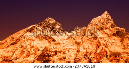 World's highest mountain, Mt Everest (8850m) and Mt. Nuptse in the Everest Region of the Himalayas, Nepal. - stock photo