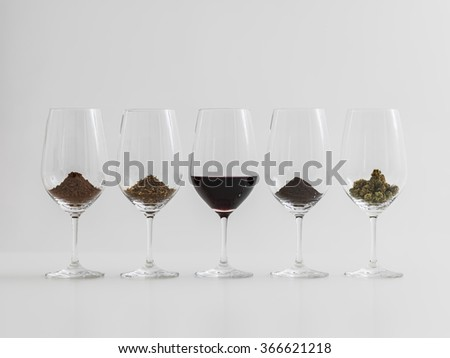 World's most popular addictions in wineglasses. Coffee, Chocolate, Wine, Cannabis, Tobacco - stock photo