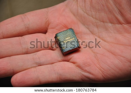 World's smallest printed New Testament. From the Reed Rare Books Collection in Dunedin, New Zealand. - stock photo