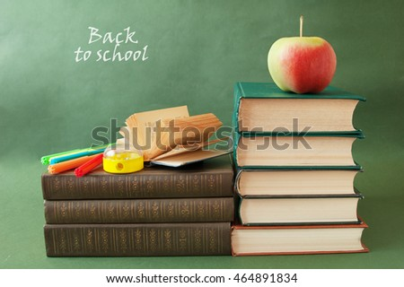 World Teacher's Day (still life with book pile, apple, globe and desk on artistic background)