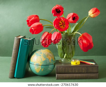 World Teacher's Day (still life with tulips bunch, book pile, globe and pencil on artistic background) - stock photo
