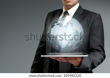 World technology communication concept. Globe from tablet pc. Touch pad interface collection. - stock photo