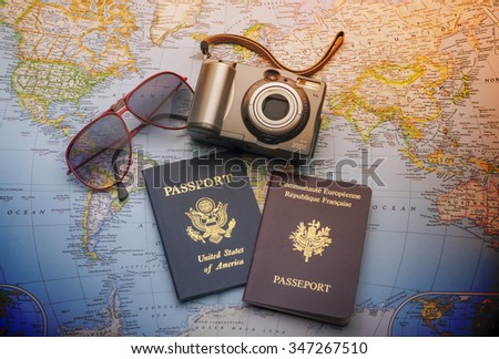 World travel with passports,sun glasses and camera - stock photo