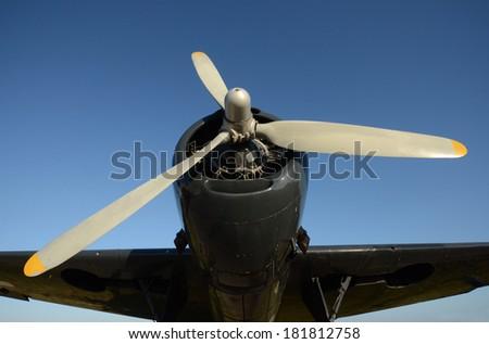 World War 2 era fighter plane front propeller view - stock photo
