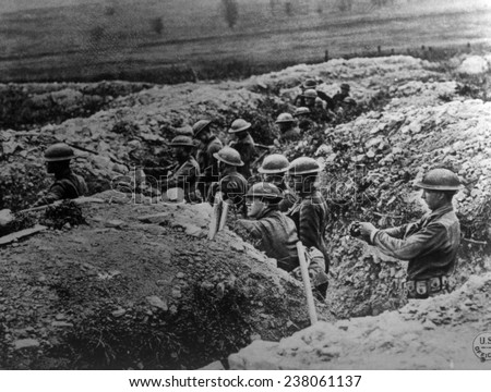 World War I, American soldiers of the 132nd Infantry, 33rd Division, in a trench at Alexandre, Meuse, France, U.S. Signal Corps photograph, 1918.
