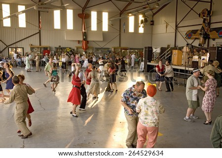 World War II actors dance in airport hanger at Mid-Atlantic Air Museum World War II Weekend and Reenactment in Reading, PA held June 18, 2008 - stock photo