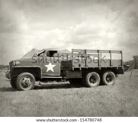 World War II era military truck at a camp - stock photo