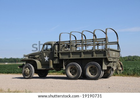 World War II era military truck on a country road - stock photo