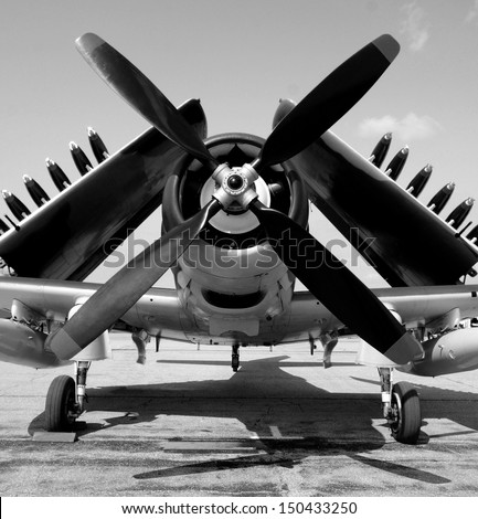 World War II era navy fighter plane with folded wings - stock photo