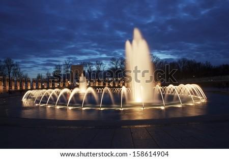 World War II Memorial Fountain at night on the National Mall in Washington DC - stock photo