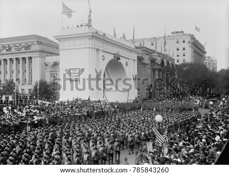 World War 1 victory parade passing a Triumphal Arch, in New York City, Sept. 10, 1919. The First Division of American Expeditionary Forces wearing trench helmets and full combat gear, marched down Fif