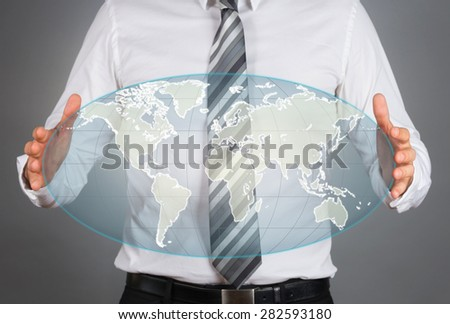 World wide concept. Business man holding virtual globe.