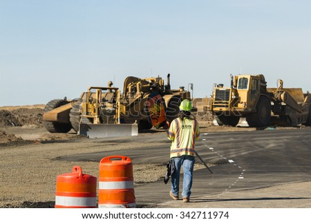 Worley, Idaho - September 23: Man in a safety vest directing traffic during construction, September 23 2015 in Worley, Idaho
