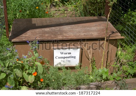 Worm composting wooden box in a garden with nightcrawlers. - stock photo