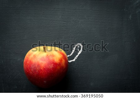 Worm looking out of Apple - stock photo