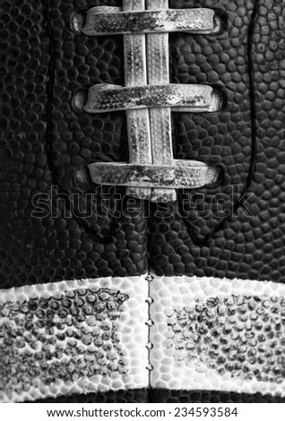 Worn American Football Close Up in Black and White - stock photo