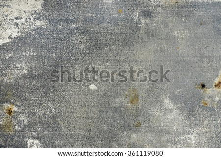 worn and scratched flat piece of steel as a grungy, textured background in silver gray tones. There are random splotches of wear and deep scratches on the surface. Horizontal composition. - stock photo
