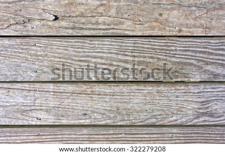 Worn and weathered pressure treated Decking Boards. - stock photo