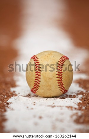 Worn Baseball on the Infield Chalk Line