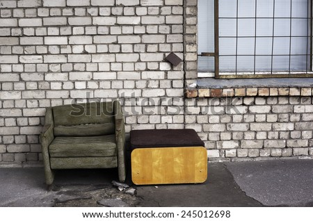 Worn chair in the street - stock photo