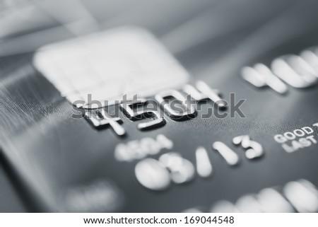 Worn credit card macro - stock photo