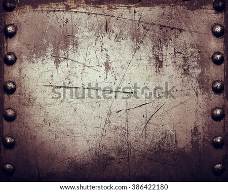 Worn metal texture with rivets - stock photo