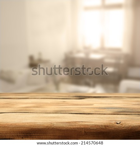 worn old desk and sunlight with window in room  - stock photo
