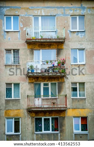 Worn-out block of flats with balconies in Latvia