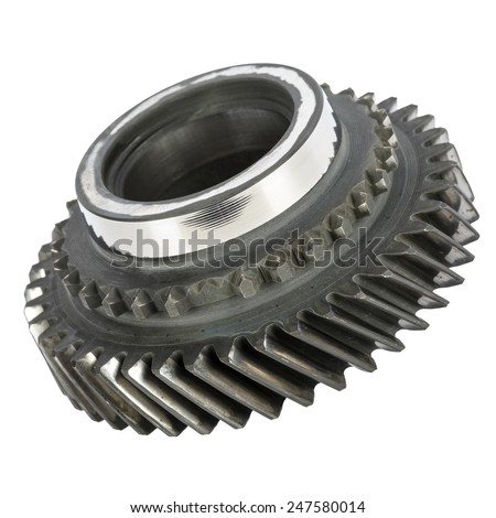Worn out cog wheel removed from the main shaft of gearbox - stock photo