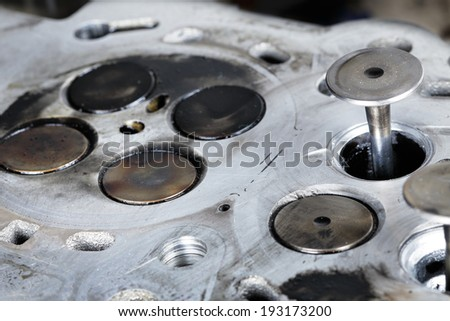 Worn out engine head with four valves per cylinder - stock photo