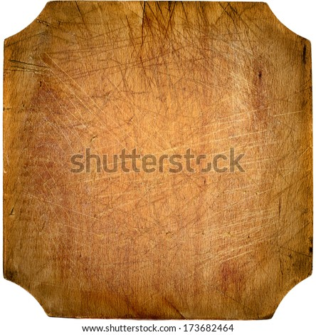 Worn out kitchen chopping wooden board with copyspace - stock photo