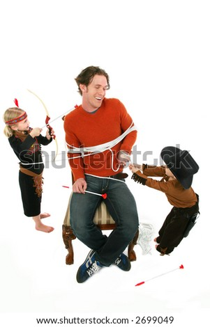 Worn out man playing cowboys and indians with young boy and girl