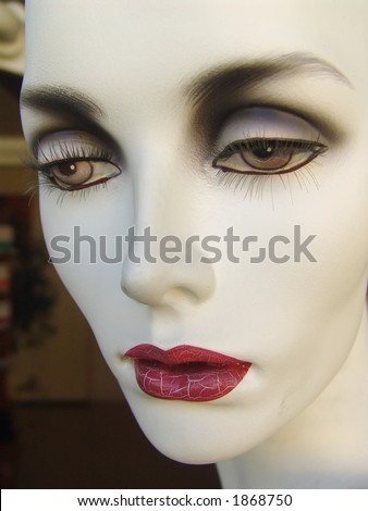 Worn out mannequin with crackled lips