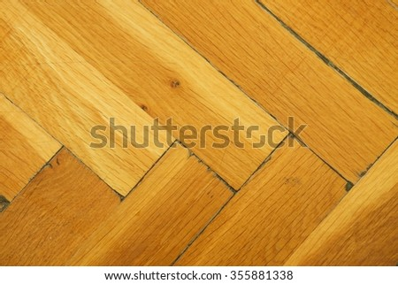 Worn out wooden floor of sports hall. Light wood flooring worn by use with defect