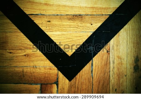 Worn out wooden floor of sports hall with colorful marking lines.  - stock photo
