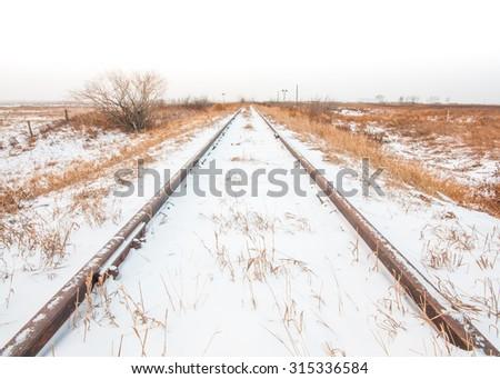 Worn tracks in a snowy landscape, Calgary, Alberta. - stock photo