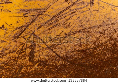 Worn yellow painted scrached off of metal texture - stock photo