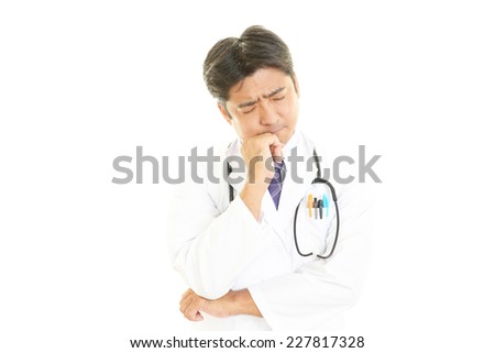Worried Asian medical doctor