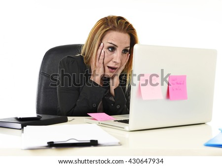 worried attractive businesswoman in stress working with laptop computer at office desk overwhelmed and overworked suffering collapse in frustrated face expression - stock photo