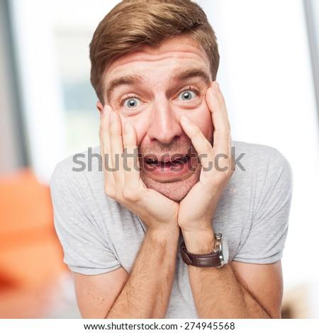 worried blond man - stock photo