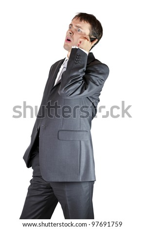 Worried businesman on a phone